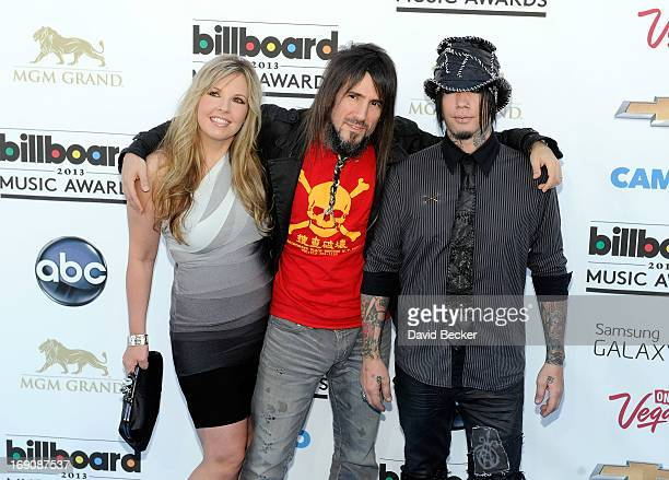 Jennifer Thal and guitarists Bumblefoot and Dj Ashba of Guns N' Roses arrive at the 2013 Billboard Music Awards at the MGM Grand Garden Arena on May...