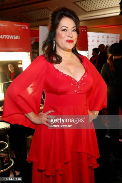 Jennifer Tilly prepares backstage at The American Heart Association's Go Red for Women Red Dress Collection 2020 at Hammerstein Ballroom on February...