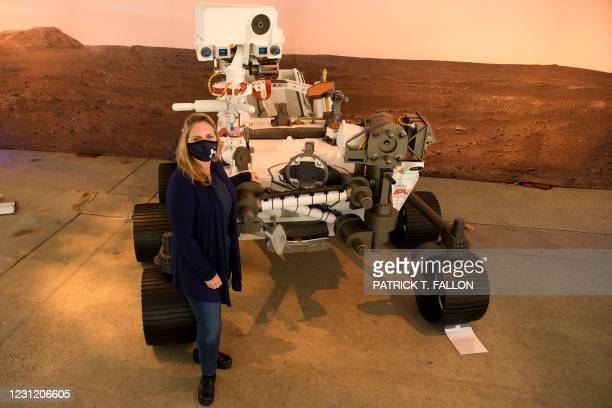 Jennifer Trosper, Perseverance deputy project manager, stands for a portrait with a full scale model of the Mars 2020 Perseverance rover at NASA's...