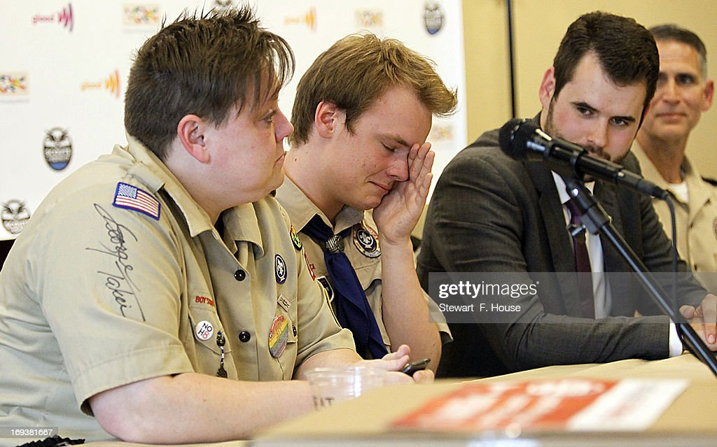 Jennifer Tyrrell (L) of Bridgeport, Ohio, speaks at a news conference as Pascal Tessier, 16, of Kensington, Maryland, wipes his eyes at a news conference held at the Great Wolf Lodge May 23, 2013 in Grapevine, Texas. The Boy Scouts of America today ended its policy of prohibitting openly gay youths from participating in Scout activities, while leaving intact its ban on gay adults and leaders. Jennifer was kicked out of the scouts as a Cub Scout den leader in 2012 for being openly gay. Pascal, who was told by Scout leaders that since he was openly gay, he could not attain the Eagle Scout rank, but was permitted to remain a Scout, will now be able to resume his pursuit of the Eagle Scout rank.