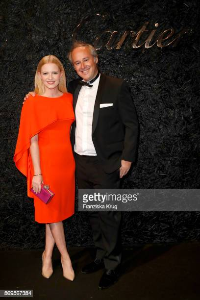 Jennifer Ulrich wearing Panthere Earrings and a Love Bracelet and Managing Director Cartier Northern Europe Renaud Lestringant attend the When the...