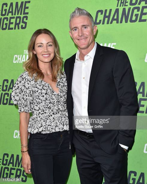 Jennifer Utley and Chase Utley attend the LA Premiere of The Game Changers at ArcLight Hollywood on September 04 2019 in Hollywood California