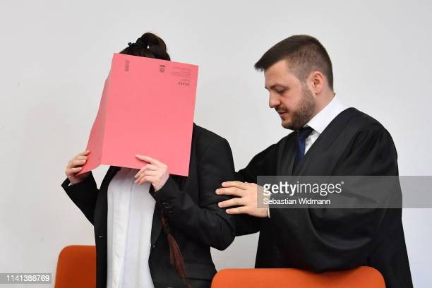 Jennifer W arrives with her lawyer Ali Aydin for the first day of her trial at the Oberlandesgericht courthouse on April 9 2019 in Munich Germany...