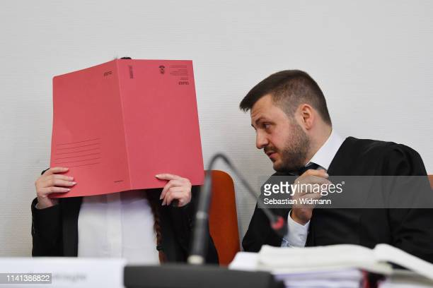 Jennifer W talks to her lawyer Ali Aydin at the first day of her trial at the Oberlandesgericht courthouse on April 9 2019 in Munich Germany Jennifer...
