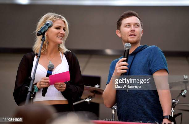 Jennifer Wayne and Scotty McCreery speak onstage during the ACM Lifting Lives TOPGOLF TeeOff at TOPGOLF on April 06 2019 in Las Vegas Nevada