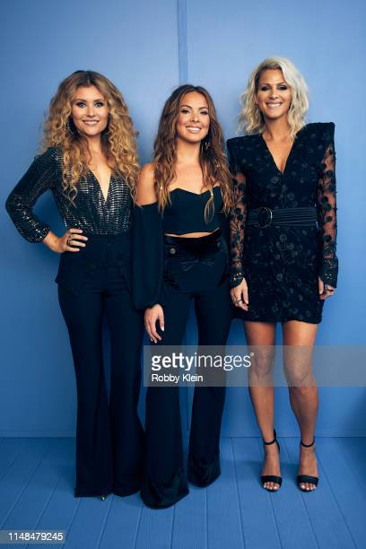 Jennifer Wayne Hannah Mulholland and Naomi Cooke of Runaway June pose for a portrait during the 2019 CMT Music Awards at Bridgestone Arena on June 5...