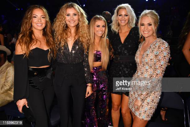 Jennifer Wayne Hannah Mulholland Lindsay Ell Naomi Cooke and Carrie Underwood2 attend the 2019 CMT Music Awards at Bridgestone Arena on June 05 2019...