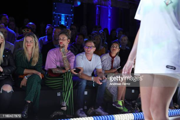 Jennifer Weist, Thomas Kretschmann and Leyla Piedayesh attend the MDLA by Bill Kaulitz fashion show during the AYFW - About You Fashion Week at ewerk...