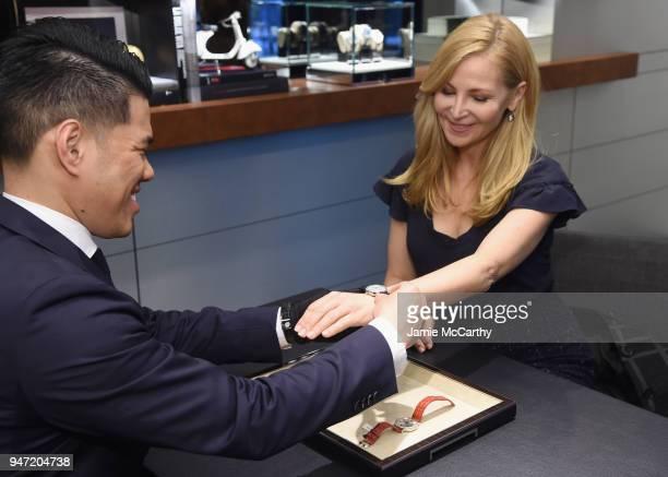 Jennifer Westfeldt tries on a watch at the IWC Tribeca Film Festival Filmmaker Award Celebration on April 16 2018 in New York City