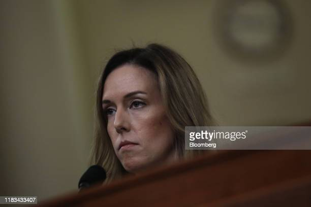 Jennifer Williams aide to Vice President Mike Pence listens during a House Intelligence Committee impeachment inquiry hearing in Washington DC US on...