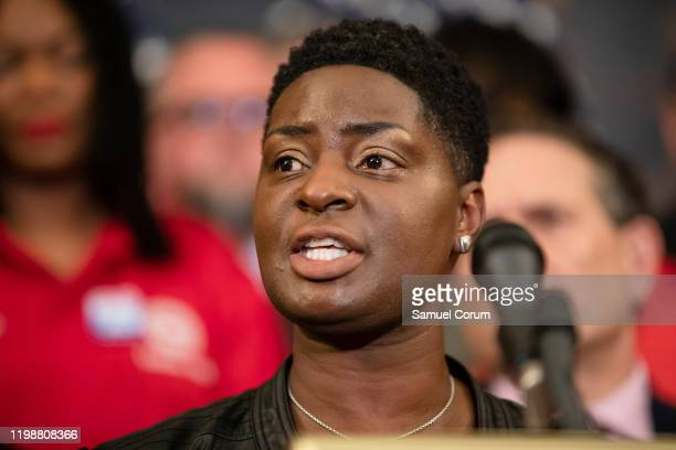 Jennifer Womack, a Verizon Wireless call center worker in Irving, TX, speaks during a press conference advocating for the passage of the Protecting...