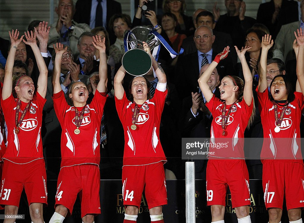 Jennifer Zietz (C) of FFC Turbine holds up the trophy after the UEFA Women's Champions League Final match between Olympique Lyonnais and FFC Turbine Potsdam at the Coliseum Alfonso Perez on May 20, 2010 in Getafe, Spain.