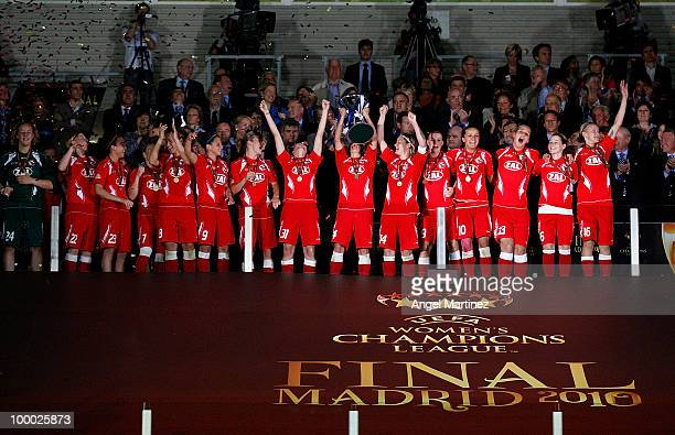 Jennifer Zietz of FFC Turbine holds up the trophy after the UEFA Women's Champions League Final match between Olympique Lyonnais and FFC Turbine...