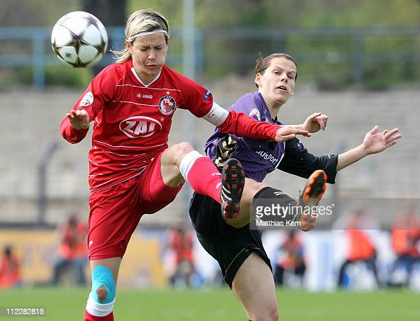 Jennifer Zietz of Potsdam competes for the ball with Jennifer Oster of Duisburg during the UEFA Women's Champions League semifinal second leg match...