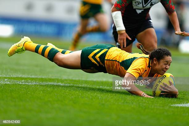 JenniSue Hoepper of Australia scores a try during the match between New Zealand and Australia in the 2015 Auckland Nines at Eden Park on January 31...
