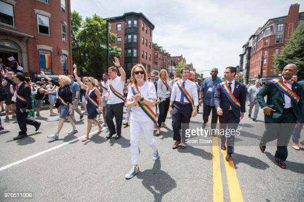 Jenny A. Durkan, mayor of Seattle, center, marches alongside dozens of mayors from around the country during the 2018 Boston Pride Parade on June 9,...