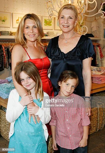 Jenny Belushi with children Jamie Belushi and Jared Belushi pose with Lorraine Sinskey during the Poppy store opening to benefit Stuart House April...