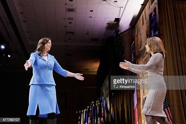 Jenny Beth Martin, president of Tea Party Patriots, left, welcomes U.S. Rep. Michele Bachmann to the stage to speak during the 41st annual...