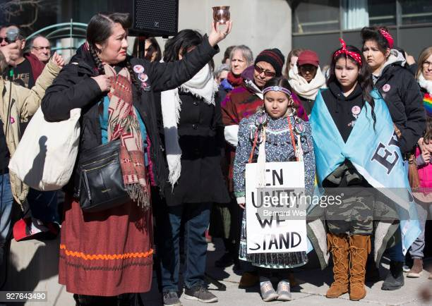 TORONTO ON MARCH 3 Jenny Blackbird from Kehewin Cree Nationm Alberta but living now in Toronto holds a cup of sacred water during speeches as...