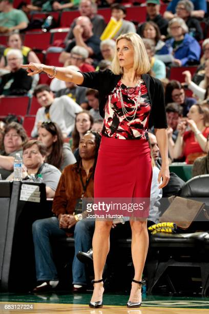 Jenny Boucek of the Seattle Storm calls out to her team during the game against the Indiana Fever on May 14 2017 at Key Arena in Seattle Washington...