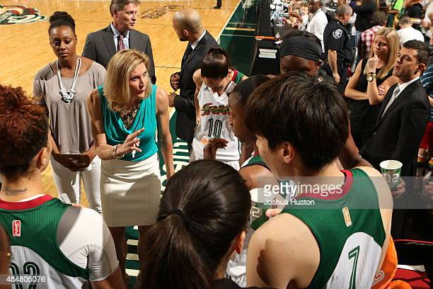 Jenny Boucek of the Seattle Storm talks to her team during a game against the Indiana Fever on August 21 2015 at Key Arena in Seattle Washington NOTE...