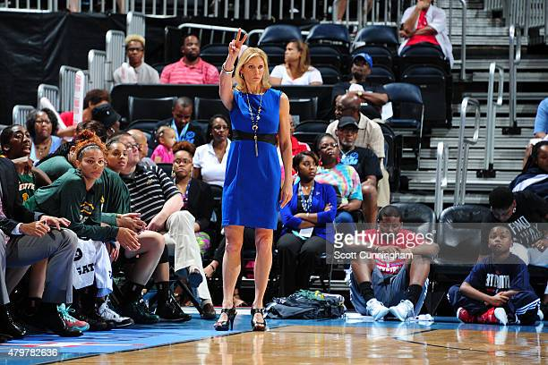 Jenny Boucek of the Seattle Storm watches her team play against the Atlanta Dream on July 5 2015 at Philips Arena in Atlanta Georgia NOTE TO USER...