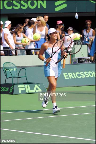Jenny Capriati with three racquets which she threw to the fans after her victory over serena williams on March 28 2001 in the Ericsson Open