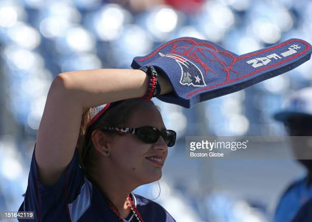 Jenny Casteel, from Hartford, Kentucky, cheers on her favorite team players at the New England Patriots season opener against the Tennessee Titans at...