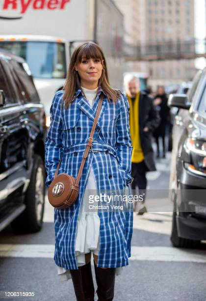 Jenny Cipoletti is seen wearing blue checkered coat brown round bag outside Michael Kors during New York Fashion Week Fall / Winter 2020 on February...