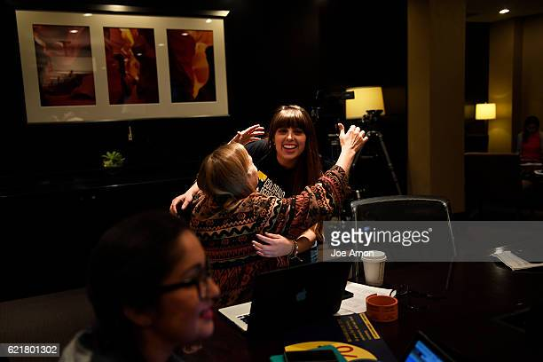 Jenny Davies is hugged by Lizeth Chacon cochair of the Colorado Families for a Fair Wage after coming inn from the field to watch for a decision on...