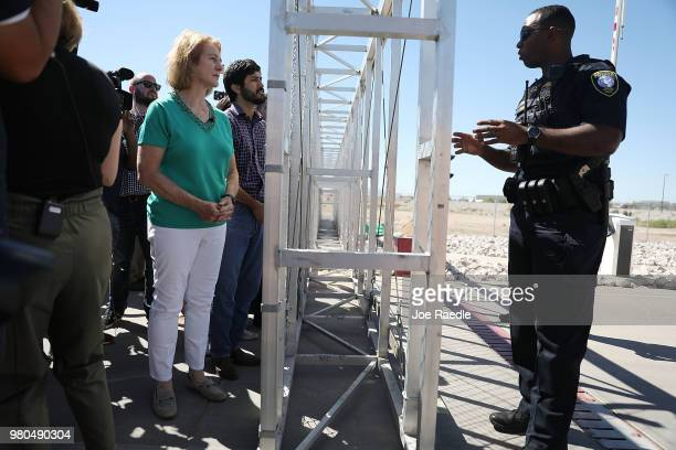 Jenny Durkan, Mayor of Seattle, Washington, speaks with a Department of Homeland Security Police officer as she is told she cannot cross through the...