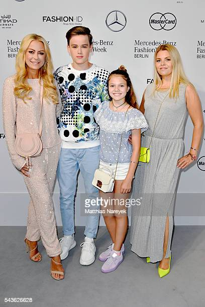 Jenny Elvers and her son Paul and Anne Sophie Briest and her daughter Faye Montana attend the Guido Maria Kretschmer show during the MercedesBenz...