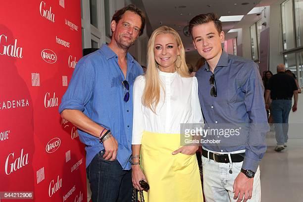 Jenny Elvers and her son Paul Elvers and her boyfriend Steffen von der Beeck attend the 'Gala' fashion brunch during the MercedesBenz Fashion Week...