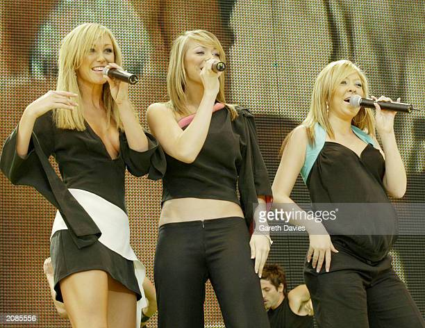 Jenny Frost Liz McClarnon and Natasha Hamilton from the British pop group Atomic Kitten perform on stage at the 958 Capital FM Party in the Park held...