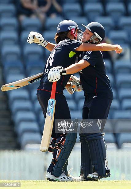 Jenny Gunn and Danielle Hazell of England embrace after winning the series during the third Twenty20 match between Australia and England at Manuka...