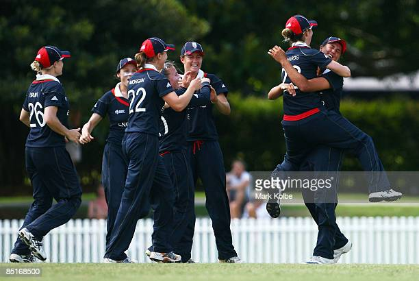 Jenny Gunn is congratulated by her captain Charlotte Edwards of England after taking an outfield catch during the ICC Women's World Cup 2009 Warm Up...