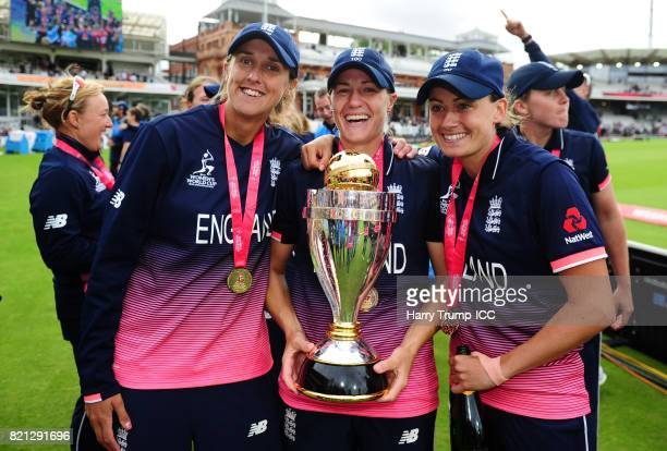 Jenny Gunn Katherine Brunt and Laura Marsh of England celebrates with the trophy during the ICC Women's World Cup 2017 Final between England and...