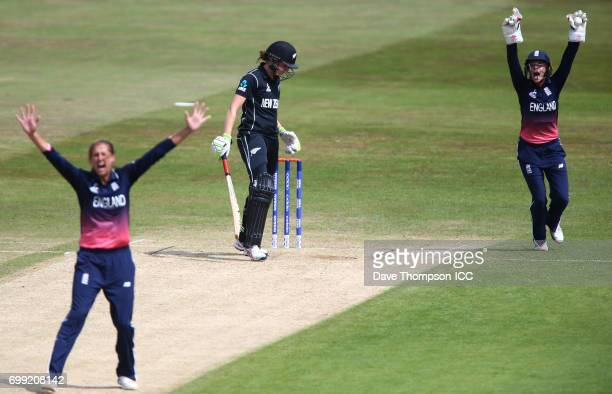 Jenny Gunn of England and Lauren Winfield of England appeal successfully for the wicket of Amy Satterthwaite of New Zealand during the ICC Women's...