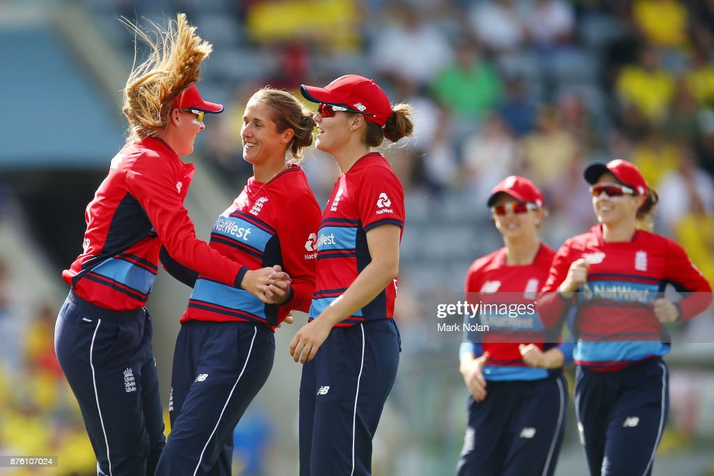 Jenny Gunn of England celebrates a wicket with team mates during the second Women's Twenty20 match between Australia and England at Manuka Oval on November 19, 2017 in Canberra, Australia.