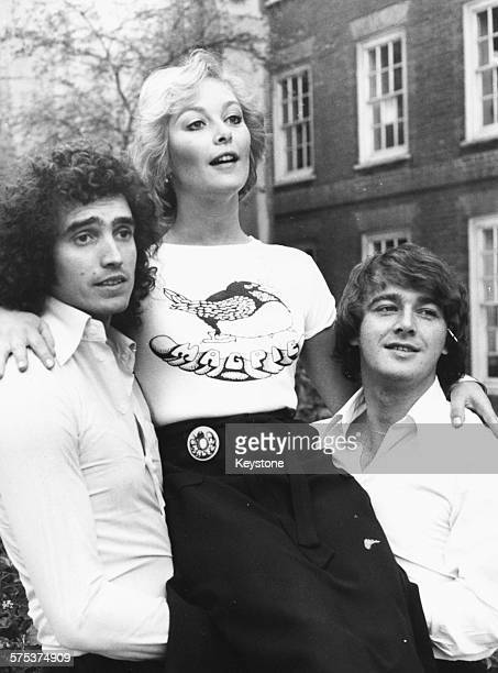 Jenny Hanley new presenter of the children's television show 'Magpie' is held up by current presents Mick Robertson and Douglas Rae to promote the...
