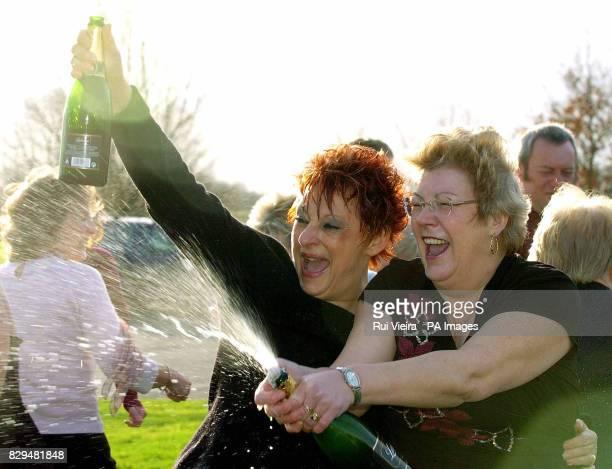 Jenny Jackman and Paula Hattersley, two of the 25 syndicate members, celebrate winning 14 469.