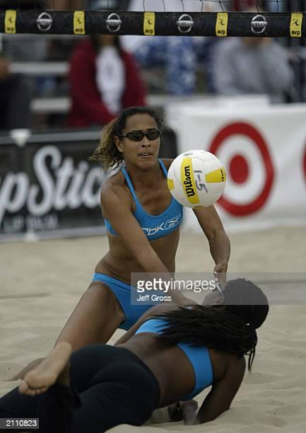 Jenny Johnson Jordan and partner Annett Davis struggle to get the ball during the AVP Nissan Series Hermosa Beach Open at the Target/Mervyn's Beach...