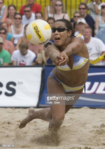 Jenny Johnson Jordan digs the ball during the women's finals against Angie Akers and Brooke Hanson in the AVP Chicago Open at North Avenue Beach on...