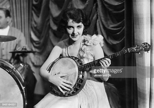 Jenny Jugo Actress Austria playing a banjo