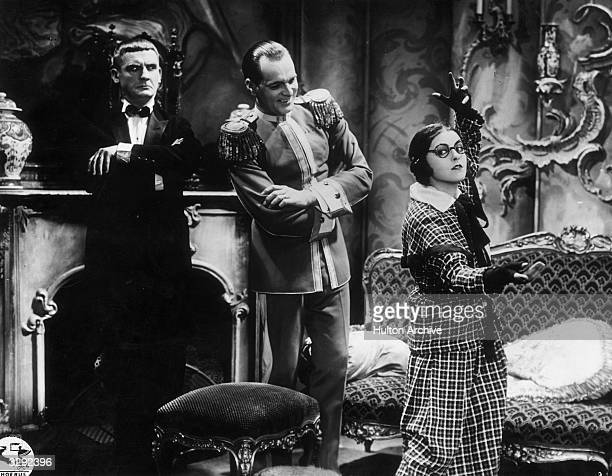 Jenny Jugo Rudolf Forster and Christian Bummerstaedt in a humerous scene from the German film 'Die Hose'