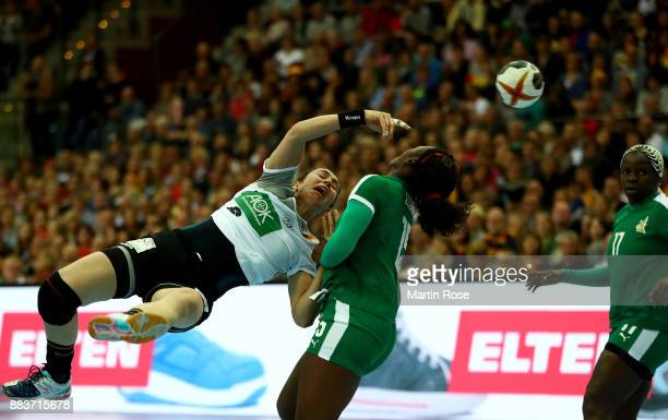 Jenny Karolius of Germany challenges Anne Michelle Essam of Cameroon during the IHF Women's Handball World Championship group D match between Germany...