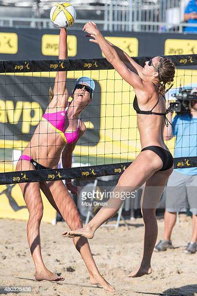 Jenny Kropp spikes the ball past Kerri Schuh at the AVP New Orleans Open at Laketown on May 23 2015 in Kenner Louisiana
