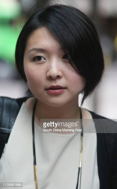 Jenny Lam, marketing, interviewed on street at Central for a vox pop on H.K.-U.S. Unpegging. 13JUN12