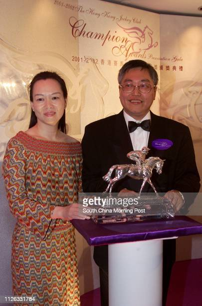 Jenny Lau and Philip Lau Sakhong owners of Fairy King Prawn show the trophy for Most Popular Horse of the Year to the media in the Champion Awards...