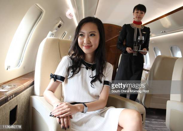 Jenny Lau President and CEO of Sion Jet pose for picture in a jet at Hong Kong International Airport in Chek Lap Kok 19SEP14